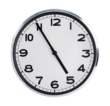 At five to five on the large wall clock Stock Photo - 17192596