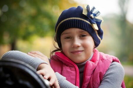 Cute little girl in a beret and jacket Stock Photo - 17276780