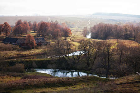 Autumn landscape with the river and the road in the distance Stock Photo - 17453514