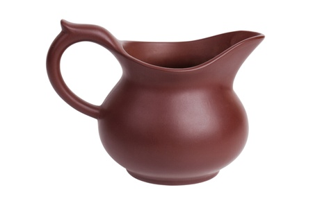teakettle: Small clay jug on a white background Stock Photo