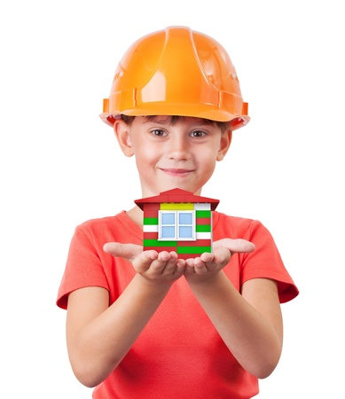 handbreadth: Little girl in a helmet holding toy house