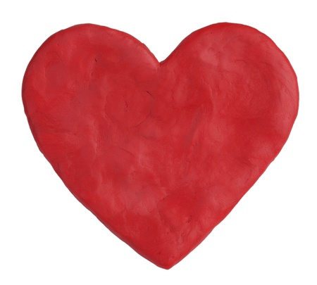 Heart, fashioned from red clay on a white background Stock Photo - 17808119
