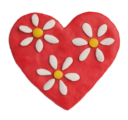 sculp: Red plasticine heart with plasticine daisies on a white background
