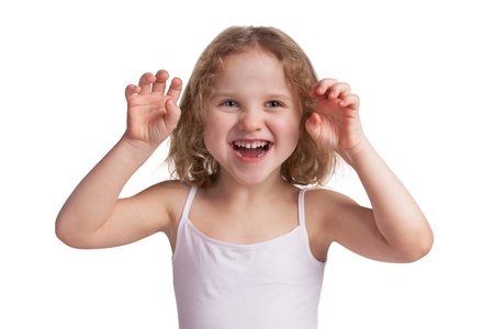 horribly: Little cheerful blonde girl playfully scare someone Stock Photo
