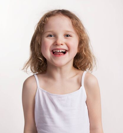 blithe: Lovely happy little girl with blond hair Stock Photo