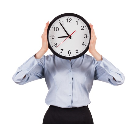 employe: Woman in a gray shirt holds a round clock Stock Photo