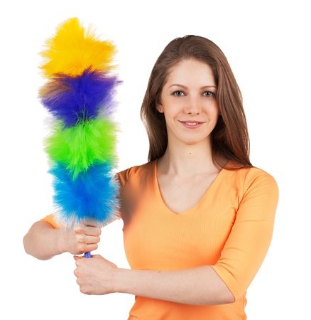 scrubbing up: Pretty woman with a brush to clean the dust