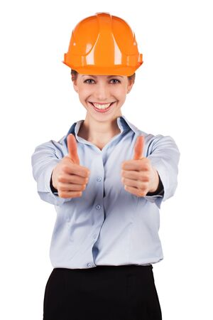Smiling woman in the building protective helmet photo