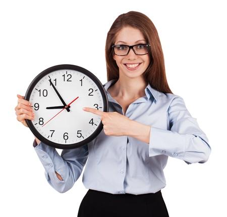 uneasiness: Mujer joven con una camisa gris con las horas de oficina Foto de archivo