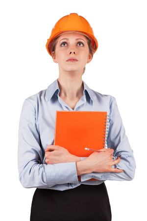 heed: Young woman in a protective helmet looking up Stock Photo