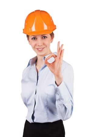 Girl in an orange helmet shows that all okay Stock Photo - 18655544
