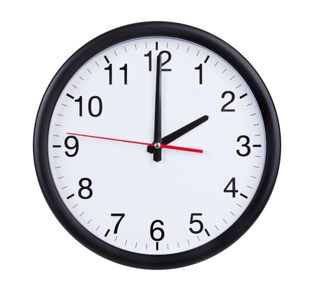 Round office clock is exactly two hours Stock Photo