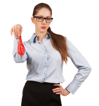 Stylish woman in glasses holding a deflated balloon