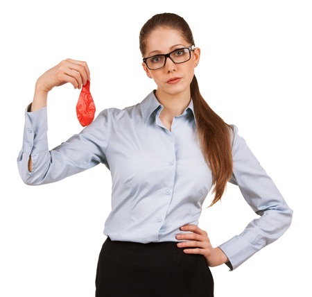 Sad young business woman holding a deflated balloon
