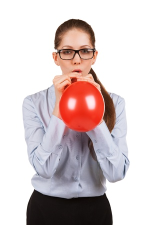 bloat: Cute girl with glasses inflating a red ball