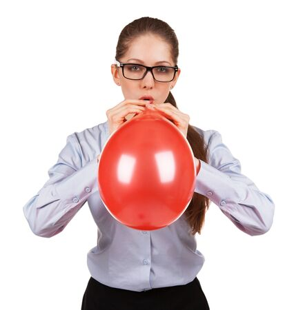 Stylish girl with glasses inflates a big red ball