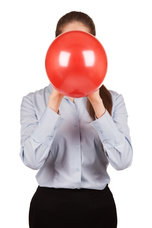 inflated: Girl in a gray shirt holds a balloon inflated