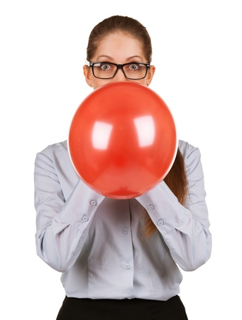 Extend: Girl with glasses inflating a large red balloon