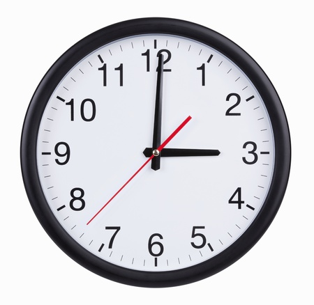 Round office clock is exactly three hours Stock Photo