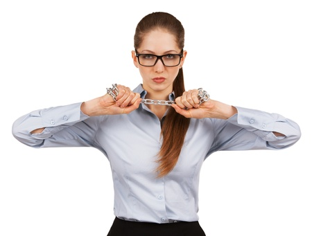 volition: Serious woman trying to break a steel chain Stock Photo