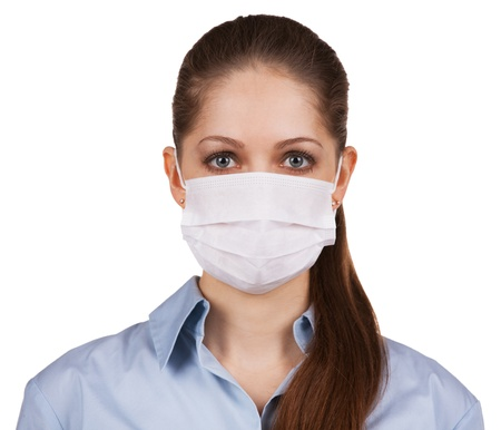 Young long-haired woman in protective medical mask photo