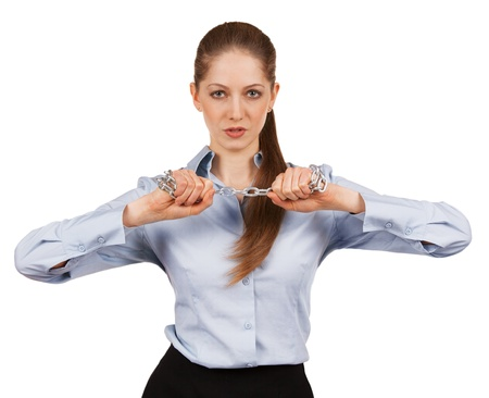 masochism: Young stylish woman trying to break a metal chain Stock Photo