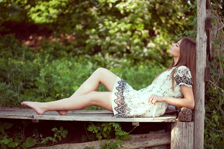 blessedness: Girl in a summer dress lying and relaxing summer day