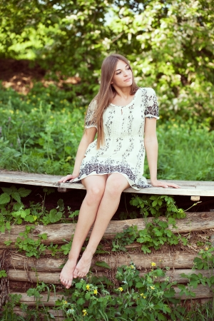beatitude: Girl in a summer dress sitting and relaxing summer day Stock Photo