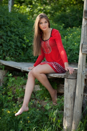 beatitude: Beautiful long-haired girl sitting with her bare feet