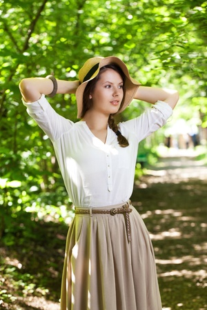 beatitude: Beautiful young woman in an elegant summer hat