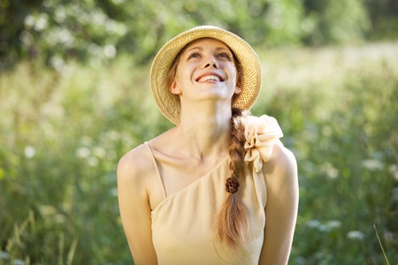 beatitude: Happy beautiful young woman on a sunny day Stock Photo