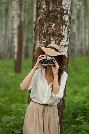 naturalist: Young woman in a hat photographed someone