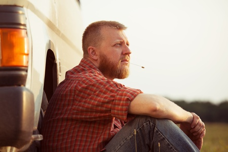 Red-bearded man in jeans on a summer evening Stock Photo