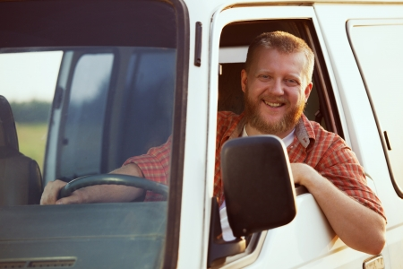 Jolly bearded driver at the wheel of his car Stock Photo