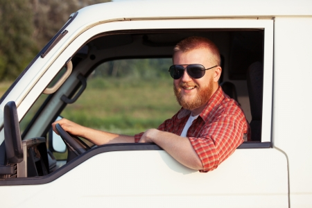 Cheerful driver of a small pickup truck