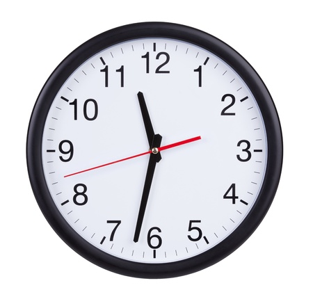 half face: Half past eleven on a round clock face Stock Photo