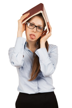 annoyance: Tired young girl with book over her head Stock Photo