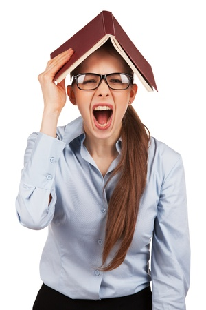 neurosis: Nervous girl with book over her head Stock Photo