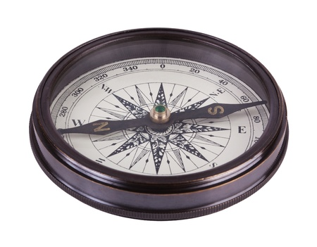 Antique brass compass lying on a white background photo