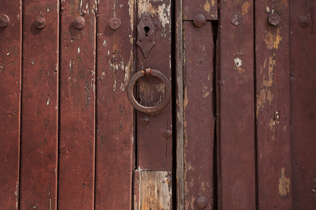 Old wooden door with rivets and a handle photo