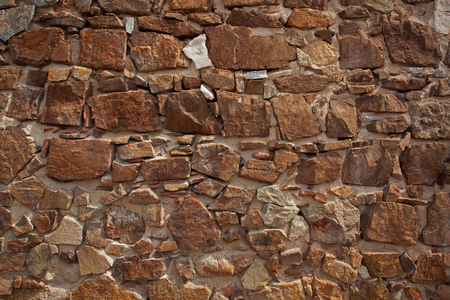 Ancient wall made from a variety of different bricks Stock Photo - 22829703