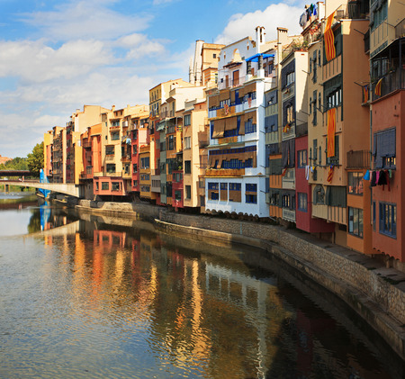 undulatory: Multi-colored houses on the banks of the river Onyar Stock Photo