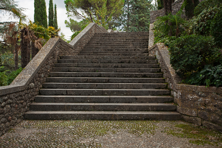 Old stone stairs in the park rises photo
