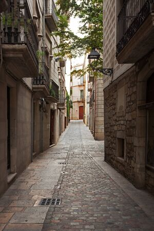 lithic: Stone houses stand along the old city streets Stock Photo