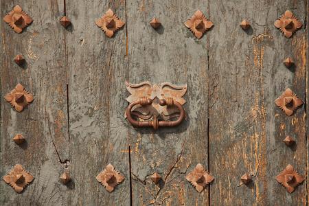 doorhandle: Green old door with doorhandle and rivets