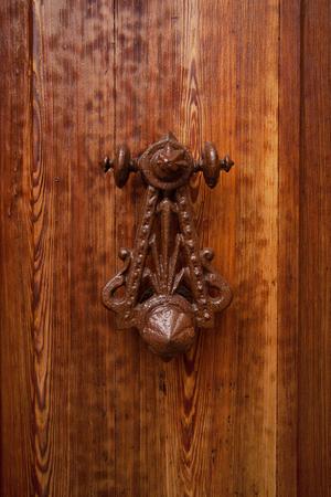 rarity: Ancient rarity doorhandle on a wooden door