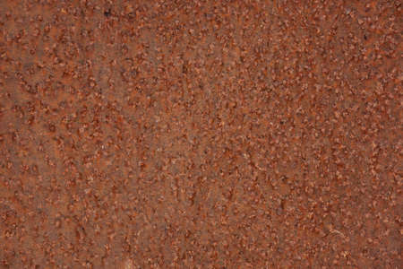 oxidate: Brown metal surface is pitted with rust Stock Photo