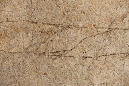 Piece of stone beige color with cracks Stock Photo - 23247522