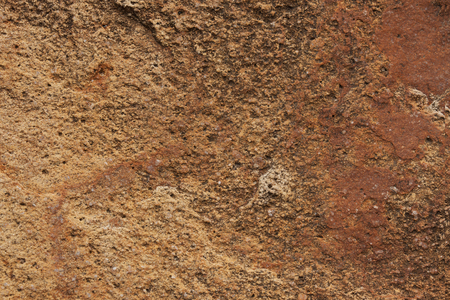 hardwearing: Surface of the brown stone with many irregularities