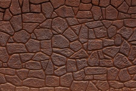Ancient wall made ​​of bricks color of rusty iron photo